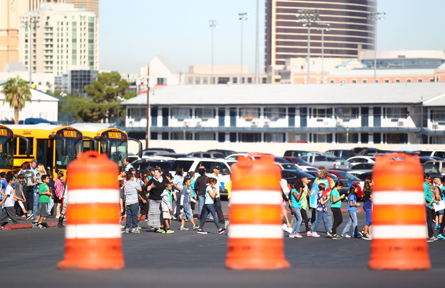 Students make their way to the Thomas & Mack Center for the Rebel Reading Challenge launch event at UNLV in Las Vegas on Wednesday, Oct. 15, 2014. The event, which featured people including Clark  ...