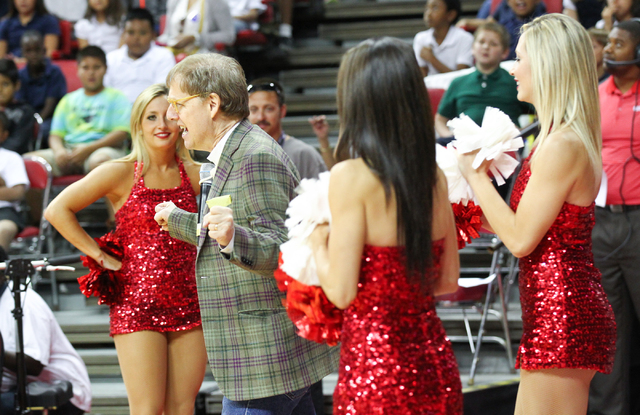 Comedy magician Mac King, second from left, enters the court area during the Rebel Reading Challenge launch event at the Thomas & Mack Center at UNLV in Las Vegas on Wednesday, Oct. 15, 2014. The  ...