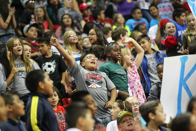 Students dance to music as the Rebel Reading Challenge launch event begins in the Thomas & Mack Center at UNLV in Las Vegas on Wednesday, Oct. 15, 2014. The event, which featured people including  ...