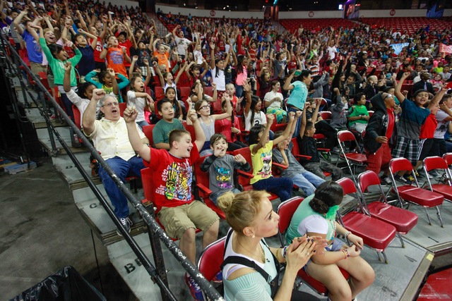 Students from Gehring Elementary School cheer during the Rebel Reading Challenge launch event at the Thomas & Mack Center at UNLV in Las Vegas on Wednesday, Oct. 15, 2014. The event, which feature ...