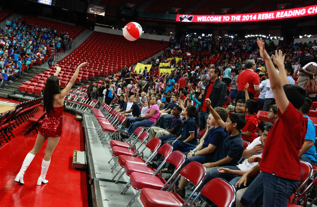 Rebel Girl Jackie Hansen, left, throws a ball to students as the Rebel Reading Challenge launch event begins in the Thomas & Mack Center at UNLV in Las Vegas on Wednesday, Oct. 15, 2014. The event ...