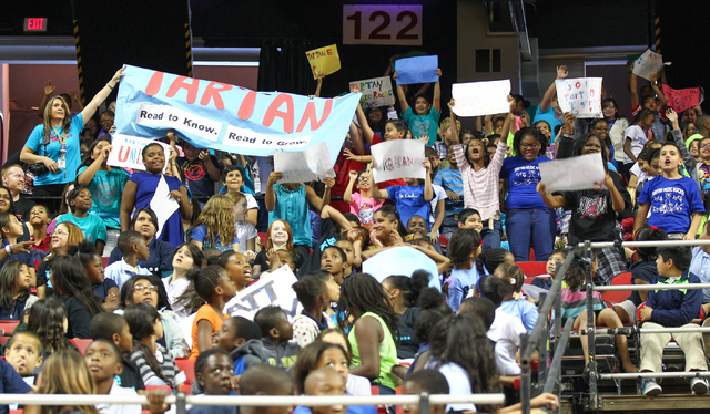Students from Tartan Elementary School cheer during the Rebel Reading Challenge launch event at the Thomas & Mack Center at UNLV in Las Vegas on Wednesday, Oct. 15, 2014. The event, which featured ...