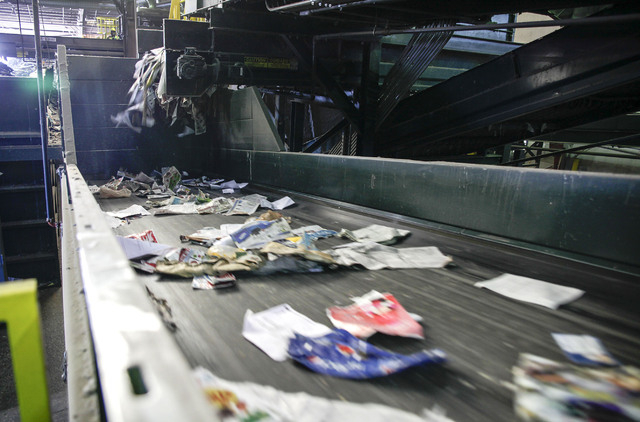 A conveyer sorts recently unloaded recyclables at the Republic Services sorting facility at 333 West Gowan Road in North Las Vegas Friday, Dec. 21, 2013. (Robert Winn/Las Vegas Review-Journal)