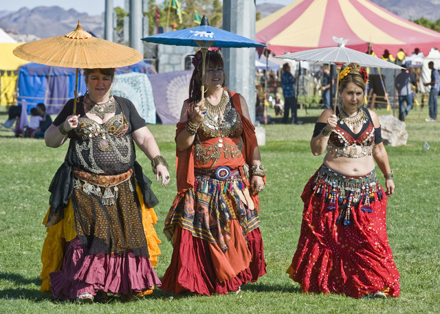From left, Bubbles Troxell, Chelle Hendrix and Jeannie Teplansky take a stroll through the Age of Chivalry Renaissance Festival grounds Oct. 7, 2011. (Jerry Henkel/View file photo)