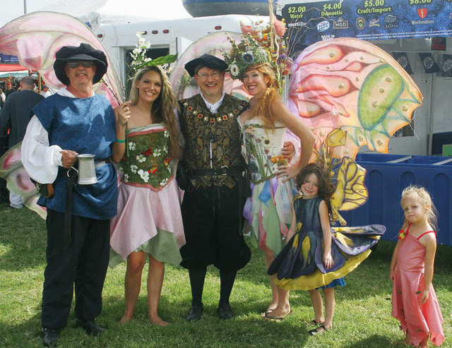 Nate Tannenbaum takes a photo with people dressed in fairy and medieval attire at the Age of Chivalry Renaissance Festival at Sunset Park.  (Special to the Las Vegas Review-Journal)