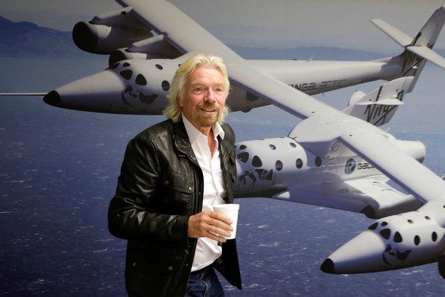 British entrepreneur Richard Branson is shown at the Virgin Galactic hangar at Mojave Air and Space Port in Mojave, California, Sept. 25, 2013. A Virgin Galactic suborbital passenger spaceship cra ...