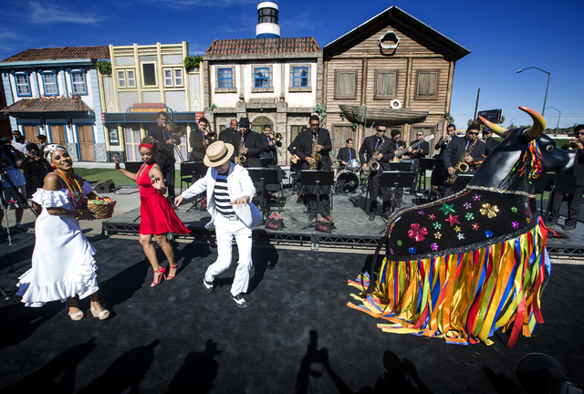 Entertainers perform during the Rock in Rock in Rio USA Rock Street sneak-peek event at the site of the former Circus Circus RV Park on Monday, Oct. 27, 2014. The permanent open-air concert venue  ...