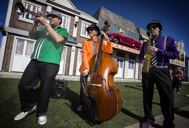 David Perrico, left, Bruce Henri Leitman, Rock Street director, and Mat Schumer perform during the Rock in Rio USA Rock Street sneak-peek event at the site of the former Circus Circus RV Park on M ...