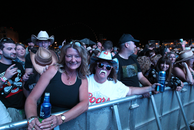 Fans pose for a photo before Brantley Gilbert performed during the Route 91 Harvest Festival at the MGM Resorts Village on the Strip on Friday, Oct. 3, 2014. (K.M. Cannon/Las Vegas Review-Journal)