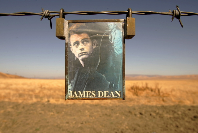 A portrait of U.S. actor James Dean hangs from a fence near the intersection of Highways 46 and 41 near Cholame, California September 30, 2005. Fans of the actor came to the site to pay respects o ...