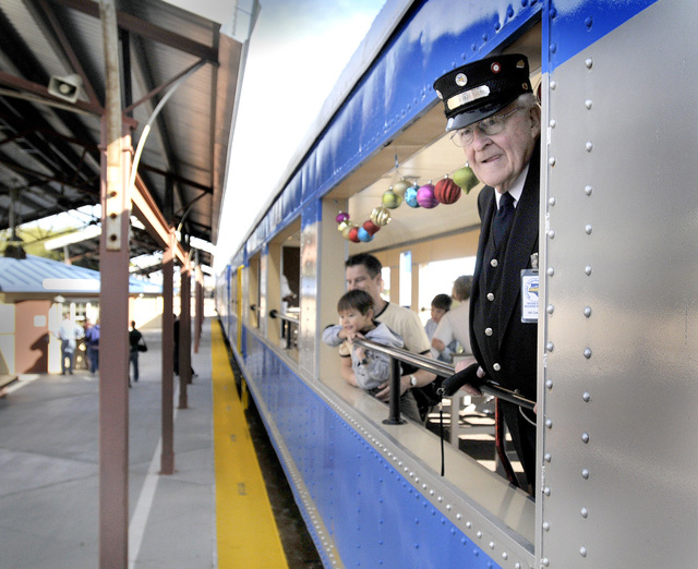 Trainman Bill Cottrell watches for the last few passengers to board the Nevada Southern Railway train before it takes off on its 45 minute ride through Boulder City, Saturday, Nov. 29, 2008. The t ...