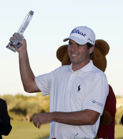 Ben Martin smiles after receiving the Shriners Hospitals for Children Open trophy from  at TPC Summerlin in Las Vegas on Sunday, Oct. 19, 2014. It was Martin's first PGA tour victory. (Justin Yurk ...