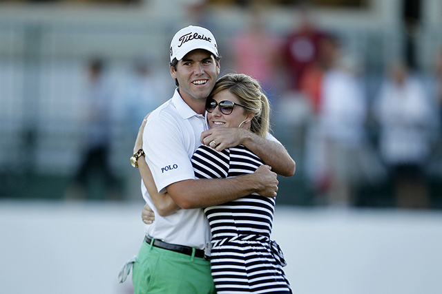 Ben Martin hugs his wife, Kelly Martin, after winning the Shriners Hospitals for Children Open at TPC Summerlin in Las Vegas on Sunday, Oct. 19, 2014. It was Martin's first PGA tour victory. (Just ...