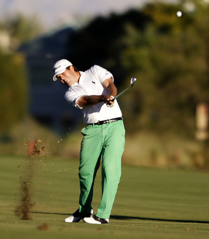 Ben Martin strikes his approach shot on the 18th hole at the Shriners Hospitals for Children Open  at TPC Summerlin in Las Vegas on Sunday, Oct. 19, 2014. It was Martin's first PGA tour victory. ( ...