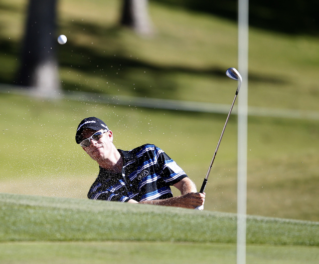 David Hearn hits his chip shot out of the bunker on the 9th   hole at the Shriners Hospitals for Children Open  at TPC Summerlin in Las Vegas on Sunday, Oct. 19, 2014.  (Justin Yurkanin/Las Vegas  ...