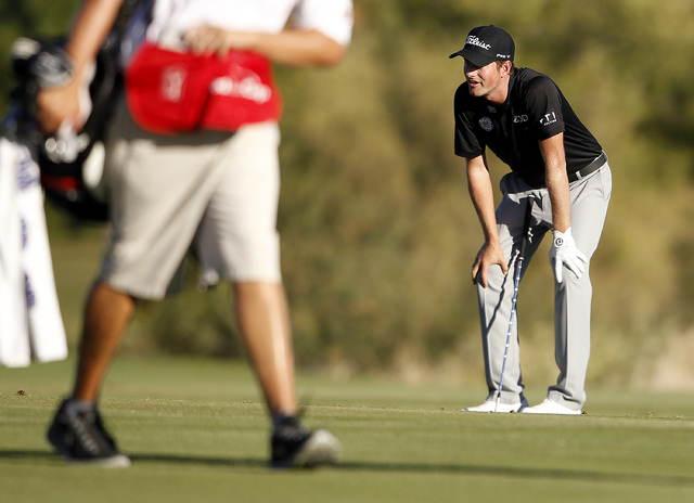 Webb Simpson reacts after leaving his approach shot on the 18th hole short of the green at the Shriners Hospitals for Children Open at TPC Summerlin in Las Vegas on Sunday, Oct. 19, 2014. (Justin  ...