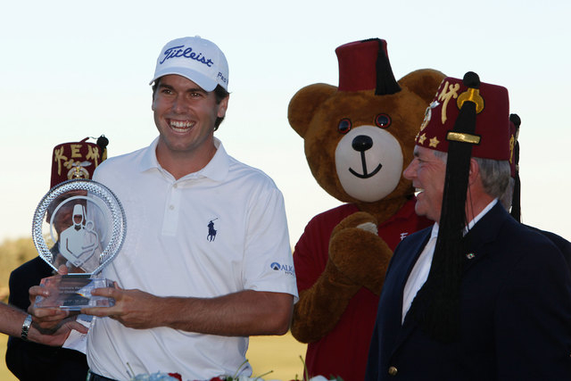 Ben Martin, left, smiles after receiving the Shriners Hospitals for Children Open trophy from Shriners Imperial Potentate Dale Stauss at TPC Summerlin in Las Vegas on Sunday, Oct. 19, 2014. It was ...