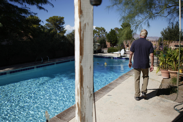 Ken Du Pont shows his pool where a sky lantern landed at his home in Henderson Wednesday, Oct. 8, 2014. The Bureau of Land Management confirmed with Du Pont that the sky lantern did not come from  ...