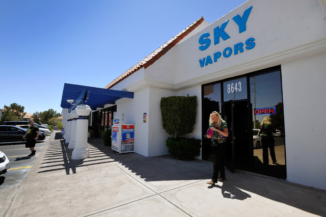 "Sky Vapors is seen on April 14, 2014. City leaders on Wednesday, Oct. 15, 2014, took first steps toward passing a bill that would require the city's tobacco purveyors and ""smoking lounge"" op ..."