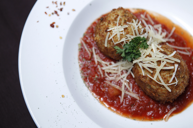 Rice balls are seen served breaded and deef friend with seasoned rice, peas, spices, and cheeses at Annie's Gourmet Italian. (Erik Verduzco/Las Vegas Review-Journal)