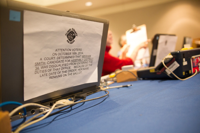 A sign stating that Assembly District 34 candidate Meghan Smith has been disqualified is seen at the early voting polling site at Sahara West Library in Las Vegas on Wednesday, Oct. 22, 2014. The  ...