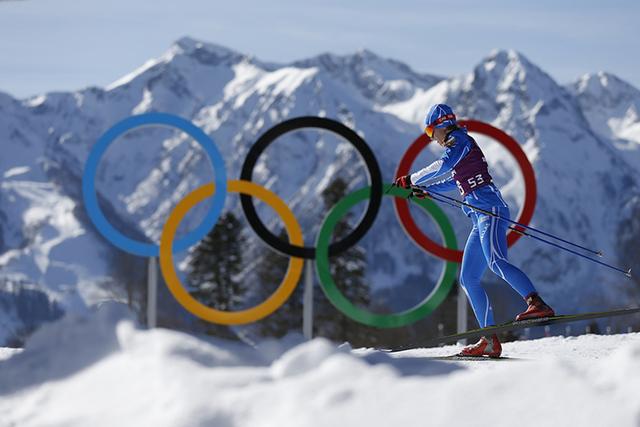 Greece's Panagiota Tsakiri passes by the Olympic rings in the Cross Country stadium prior to the 2014 Winter Olympics, Friday, Feb. 7, 2014, in Krasnaya Polyana, Russia. (AP Photo/Felipe Dana)