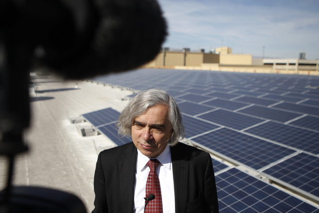 U.S. Department of Energy Secretary Ernest Moniz is interviewed during a tour of a solar panel installment project on the roof of Mandalay Bay Convention Center in Las Vegas Wednesday, Oct. 22, 20 ...