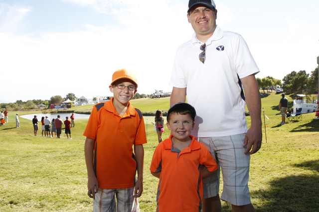Cooper Nelson, from left, 9, his brother Jack, 4, and father Derek, pose for a portrait at the Shriners Hospitals for Children Open golf tournament at TPC Summerlin, 1700 Village Center Circle, in ...