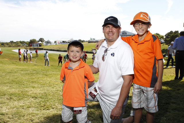 Jack Nelson, from left, 4, his father Derek, and brother Cooper, 9, pose for a portrait at the Shriners Hospitals for Children Open golf tournament at TPC Summerlin, 1700 Village Center Circle, in ...