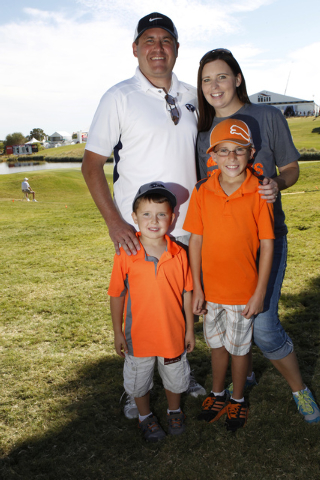 Derek Nelson, clockwise from back left, his wife Kellie, and their sons Cooper, 9, and Jack, 4, pose for a portrait at the Shriners Hospitals for Children Open golf tournament at TPC Summerlin, 17 ...