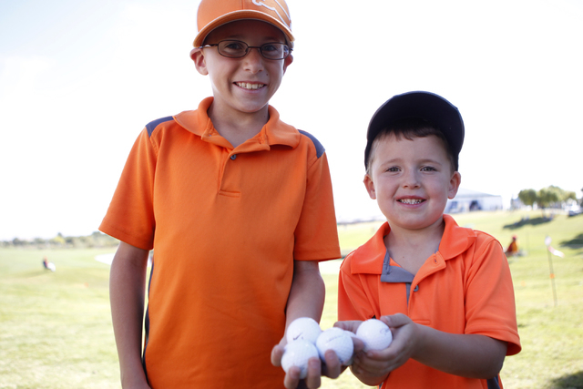 Cooper Nelson, left, 9, and his brother Jack, 4, show golf balls they have collected during the Shriners Hospitals for Children Open golf tournament at TPC Summerlin, 1700 Village Center Circle, i ...