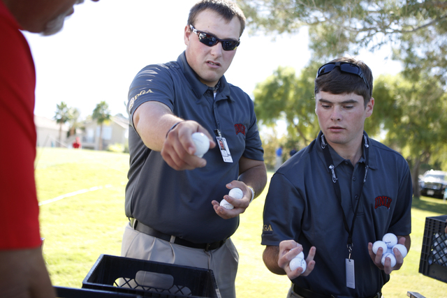 Austin Snow, left, and Shane Morrison, volunteers with the UNLV Professional Golf Management programt, assort golf balls at TPC Summerlin, 1700 Village Center Circle, in Las Vegas Tuesday, Oct. 14 ...