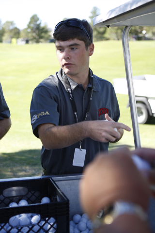 Shane Morrison, volunteer with the UNLV Professional Golf Management program, assort golf balls at TPC Summerlin, 1700 Village Center Circle, in Las Vegas Tuesday, Oct. 14, 2014. Golfers are prepa ...