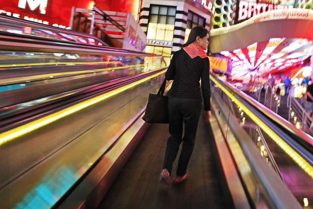 A woman rides a moving walkway towards Planet Hollywood on the Strip Wednesday, Oct. 22, 2014. (Sam Morris/Las Vegas Review-Journal)