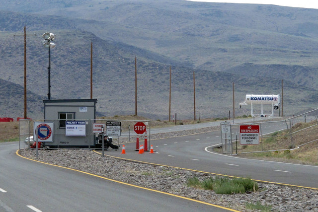 Security guards stand at the gate to the Tahoe Reno Industrial Center in Sparks on Aug. 1, 2014, where Tesla Motors has broken ground as one of the possible places to build a $5 billion Gigafactor ...