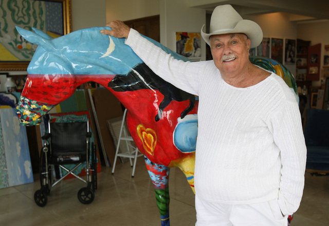 "Actor and artist Tony Curtis pose with ""Shiloh"" a horse statue he painted and that is on display in his Las Vegas home, Thursday, March 25, 2010. (John Gurzinski/Las Vegas Review-Journal)"