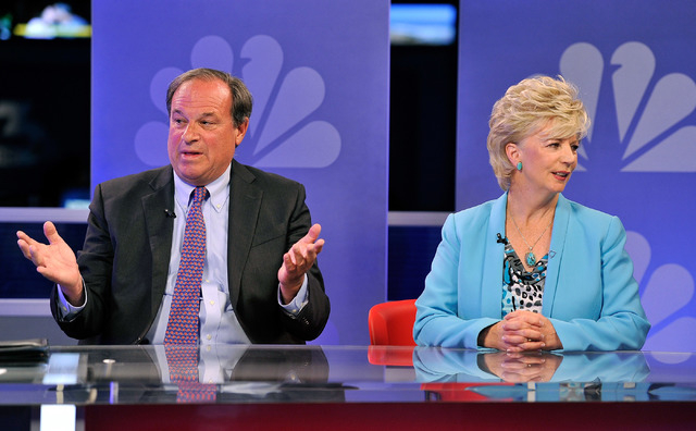 """Nevada treasurer candidates Republican Dan Schwartz, left, and Democrat Kim Wallin appear during a debate on the """"Ralston Reports,"""" show at the KSNV studios in Las Vegas on Tuesday, Oct. ..."""