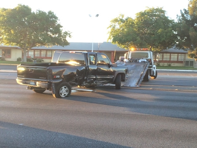 A tow truck prepares to remove a truck involved in an accident at Tropicana Avenue and Swenson Street Friday morning, Oct. 31, 2014. (Bizu Tesfaye/Las Vegas Review-Journal)