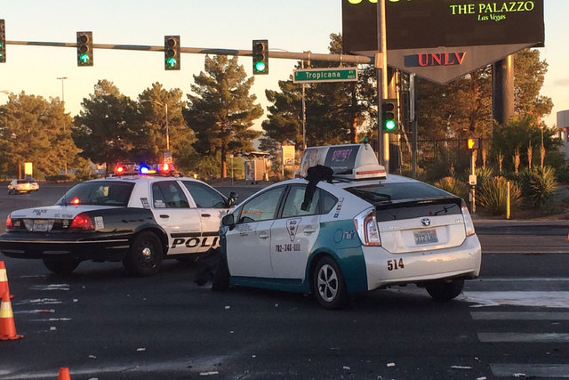 An accident at Tropicana Avenue and Swenson Street early Friday morning, Oct. 31, 2014, closed the eastbound lanes of Tropicana. (Bizu Tesfaye/Las Vegas Review-Journal)