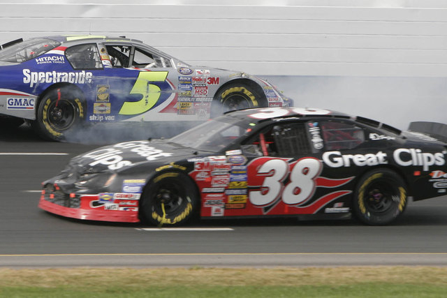 Tyler Walker (38) races against Boston Reid (5) in the NASCAR Busch Series New England 200 in 2005. Walker on Tuesday, Oct. 28, 2014, was expected to take a plea deal on DUI and drug charges filed ...
