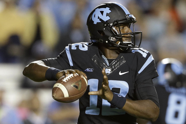 North Carolina quarterback Marquise Williams looks to pass the ball during the first half of an NCAA college football game against Georgia Tech in Chapel Hill, N.C., Saturday, Oct. 18, 2014. (AP P ...