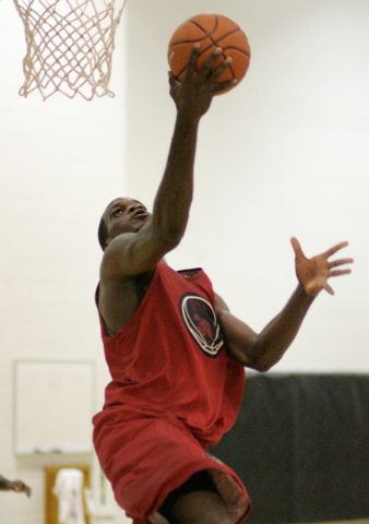 UNLV basketball player Joel Anthony goes up for a layup during practice at the Cox Pavilion practice court in Las Vegas Friday, Oct. 13, 2006. It is the first offical practice for the Rebels of th ...
