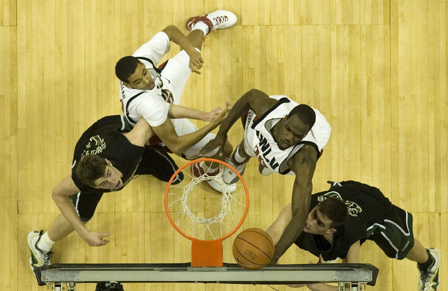 Joel Anthony, top right, of UNLV makes a layup as teammate Rene Rougeau, top left, watches along with Tyler Smith, left, and Stuart Creason of Colorado State during their game at the Thomas & Mack ...