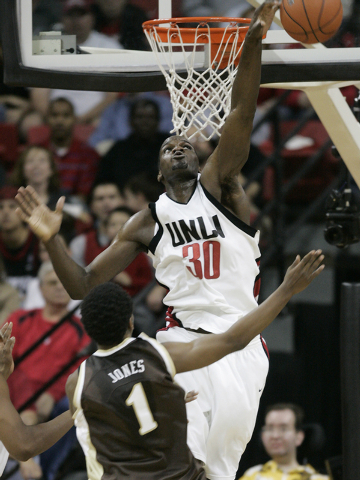 UNLV basketball player Joel Anthony blocks a shot by Brad Jones of Wyoming the the second half of their game at the Thomas & Mack Center Saturday, Feb. 10, 2007, in Las Vegas. (Jan Kalinowsky/Las  ...