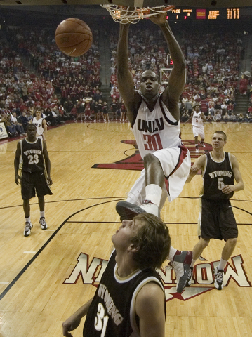 UNLV basketball player Joel Anthony slam dunks the ball during the first half of the Rebels game against Wyoming at the Thomas & Mach Center Saturday, Feb. 10, 2007, in Las Vegas. (John Locher/Las ...