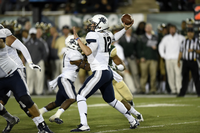 Utah State Aggies quarterback Craig Harrison (12) passes in the fourth quarter against the Colorado State Rams on Oct. 18, 2014 at Hughes Stadium. The Rams defeated the Aggies 16-13. (Ron Chenoy-U ...