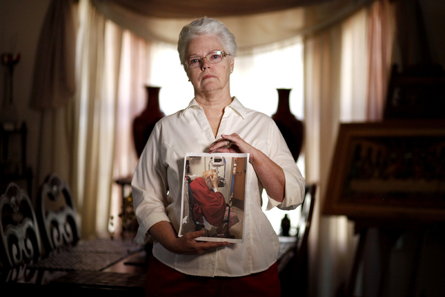 Dee Redwine holds a picture of Sandi Niccum at her home in North Las Vegas on Wednesday, Oct. 15, 2014. Niccum, a blind retired Navy veteran, died on November 15, 2013. Redwine accompanied Niccum  ...