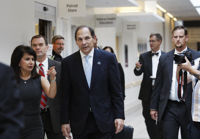 Newly confirmed Veteran's Affairs Secretary Robert McDonald, middle, gets led on a tour of the VA Medical Center in North Las Vegas by Medical Center Director Isabel Duff, left, during his visit o ...