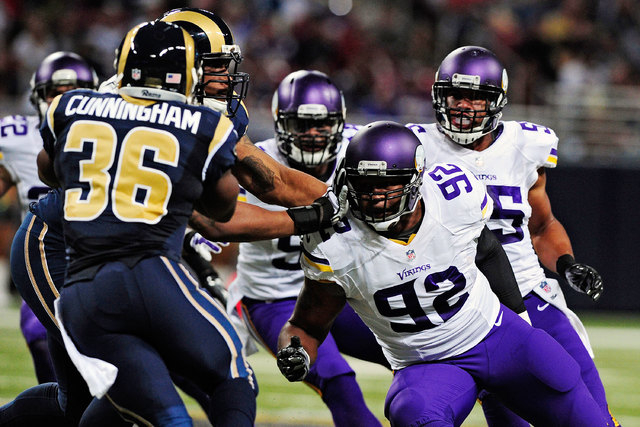 Minnesota Vikings tackle Tom Johnson (92), right, defends against St. Louis Rams running back Benny Cunningham (36) on Sept. 7, 2014. Johnson and Miami Dolphins defensive end Derrick Shelby were a ...