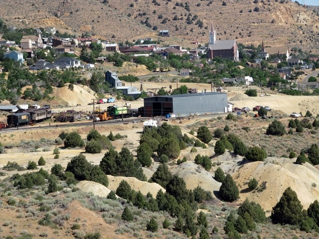 Old tailing piles from former mining operations dot the landscape around Virginia City, July 25, 2011. When Virginia City was booming in the 1870s, water supplies became a problem. (AP Photo/Sandr ...